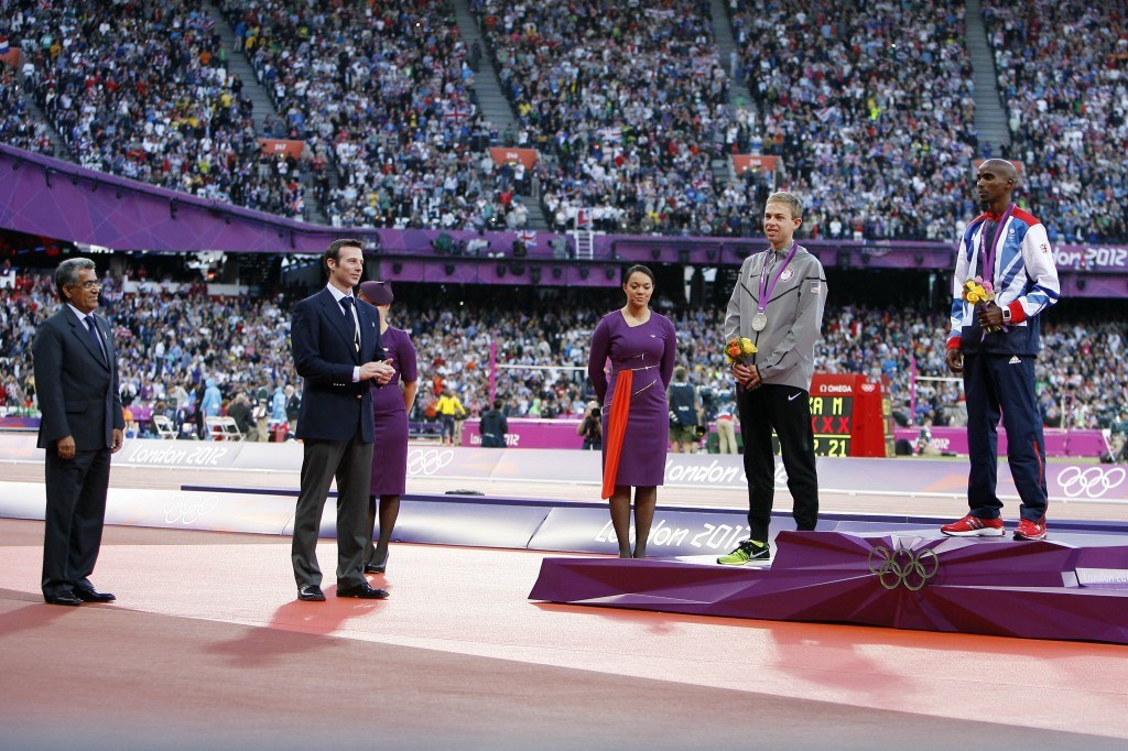 Mr. Kamali at the 2012 Olympics presenting to Mo Farah